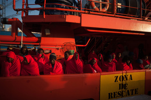 Subsaharan migrants, who were rescued from a dinghy at the Mediterranean Sea, are seen standing on a rescue vessel after their arrival at the Port of Malaga. A total of 61 migrants were rescued by Spain's Maritime Rescue Service and brought them to Malaga harbor where were assisted by the Spanish Red Cross. A total of 61 migrants were rescued from a dinghy at the Mediterranean Sea by Spain's Maritime Rescue Service and brought them to Malaga harbor where they were assisted by the Spanish Red Cross.