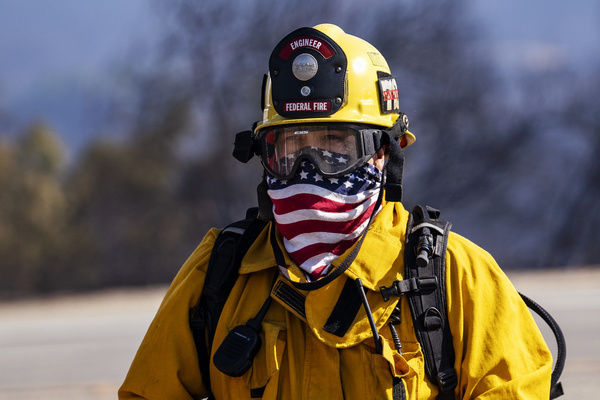 A firefighter wears a bandana with the American flag during the Easy Fire near the Ronald Reagan Presidential Library in Simi Valley, California. The fire spread quickly due to strong Santa Ana winds with wind gusts reaching up to 70 mph in some areas. The National Weather Service issued a rare extreme red flag warning to the greater Los Angeles area.  The fire prompted mandatory evacuations.