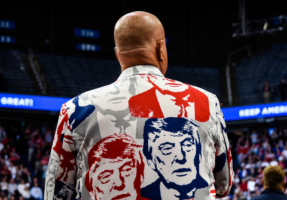 A rally-goer donning a head-to-toe Donald Trump suit waits for President Trump to take the stage at a rally in Lexington, Kentucky on Monday night.