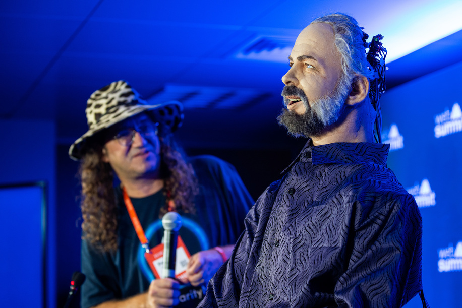 Ben Goertzel, SingularityNET Founder and CEO (L), gives a press conference with Hanson Robotics, Philip K. Dick Robot (R) during the day 3 of the annual Web Summit technology conference in Lisbon.