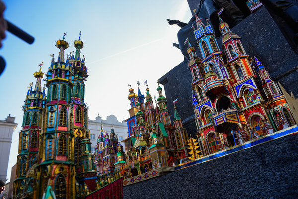 KRAKOW, POLAND, DECEMBER 5, 2019: View of the nativity scenes during the 77th edition of Christmas Cribs competition at the Main Square. One of Krakow's most idiosyncratic Christmas traditions is the popular creation of 'szopki' or 'Christmas cribs'. Something of a strange cross between a nativity scene, gingerbread house, and dollhouse, these unique structures more resemble colourful, foil-covered castles or cathedrals than cribs, and are the bizarre result of a folk tradition dating back to the Middle Ages.