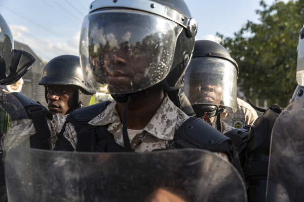 A phalanx of Haitian police form a barricade to keep protesters from getting any closer to the US Embassy during the demonstration. For over a year tensions has been high in Haiti, widespread governmental corruption and the misuse of Venezuelan loans through the Petro Caribe program has led many people to take to the streets demanding that President Jovenel Moïse steps down. Country wide protests and the threat of violence has brought the nation to a near standstill with many businesses and schools have now been shuttered for months. With both sides digging in there seems no end in sight.