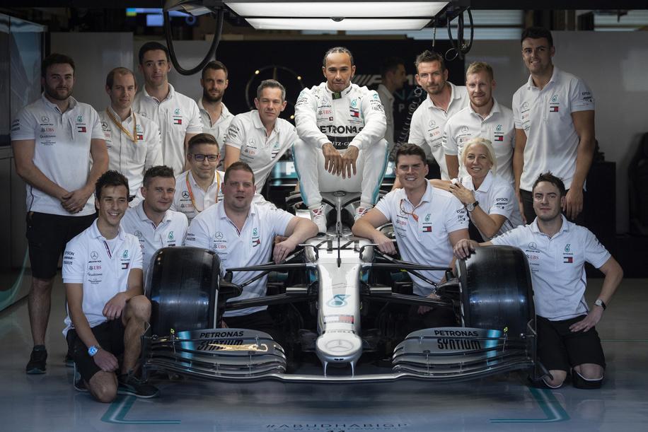 ABU DHABI, UAE, NOVEMBER 28, 2019: Mercedes AMG Petronas F1 Team's British driver Lewis Hamilton poses for photos with his team prior to the start of the Abu Dhabi Formula 1 Grand Prix weekend at the Yas Marina Circuit in Abu Dhabi.