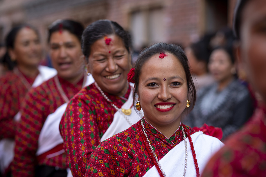 Devotees smile during the Indrayani festival. Annually, people of Kirtipur celebrate Indrayani Jatra which is a part of Satgaule Jatra. Jatra also symbolizes brotherhood and arrival of winter.