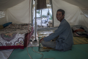 Rian (31 years old) relaxes after praying in a makeshift tent. At the Balaroa evacuation post there are still 251 families or 1,010 residents who are victims of the earthquake, many residents did not move to the refugee camps because the temporary shelter (huntara) provided by the government did not meet their needs, though there are also families that want a shelter but not entitled to receive shelters cause their houses were not affected by the earthquake. To survive in the post, a number of refugees run various businesses like selling children's snacks and other odd jobs.