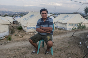 Usman (60 years old) relaxes close to tents. At the Balaroa evacuation post there are still 251 families or 1,010 residents who are victims of the earthquake, many residents did not move to the refugee camps because the temporary shelter (huntara) provided by the government did not meet their needs, though there are also families that want a shelter but not entitled to receive shelters cause their houses were not affected by the earthquake. To survive in the post, a number of refugees run various businesses like selling children's snacks and other odd jobs.