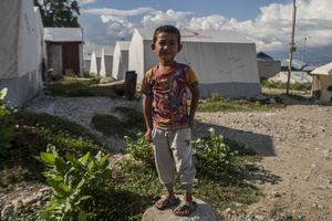 Andri, an eight-year-old child poses in front of a makeshift tent. At the Balaroa evacuation post there are still 251 families or 1,010 residents who are victims of the earthquake, many residents did not move to the refugee camps because the temporary shelter (huntara) provided by the government did not meet their needs, though there are also families that want a shelter but not entitled to receive shelters cause their houses were not affected by the earthquake. To survive in the post, a number of refugees run various businesses like selling children's snacks and other odd jobs.