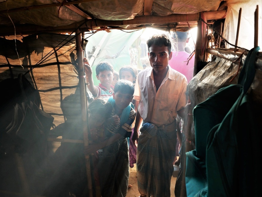 A Rohingya refugee family seen looking into their temporary accomodation tent in the Kutupalong Refugee Camp. Even Pope Francis was not allowed to say a word