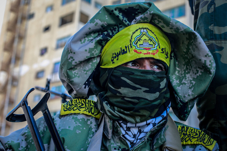 Palestinian gunman from the Al-Aqsa Martyrs Brigades during the 55th anniversary of the Fatah movement founding in Gaza City.