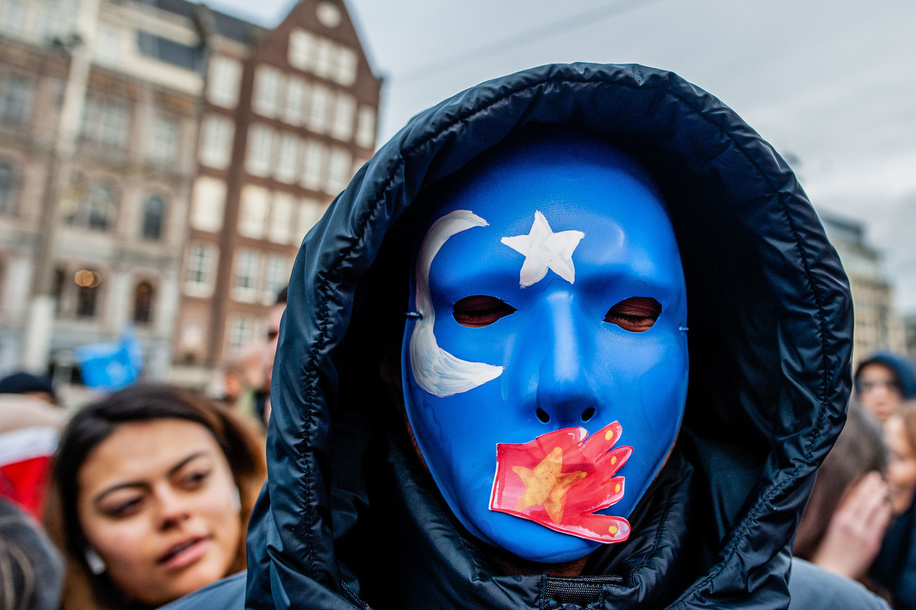 A protester wears a blue red mask during the demonstration.Hundreds of people gathered at the Dam Square to show their support with China's ethnic Uighurs. The Chinese government has reportedly detained more than a million Muslims at re-education camps. Most of the people who were arbitrarily detained are Uighur, a predominantly Turkic-speaking ethnic group primarily from Chinaís north-western region of Xinjiang. Human rights organisations, UN officials, and many foreign governments are urging China to stop the crackdown.