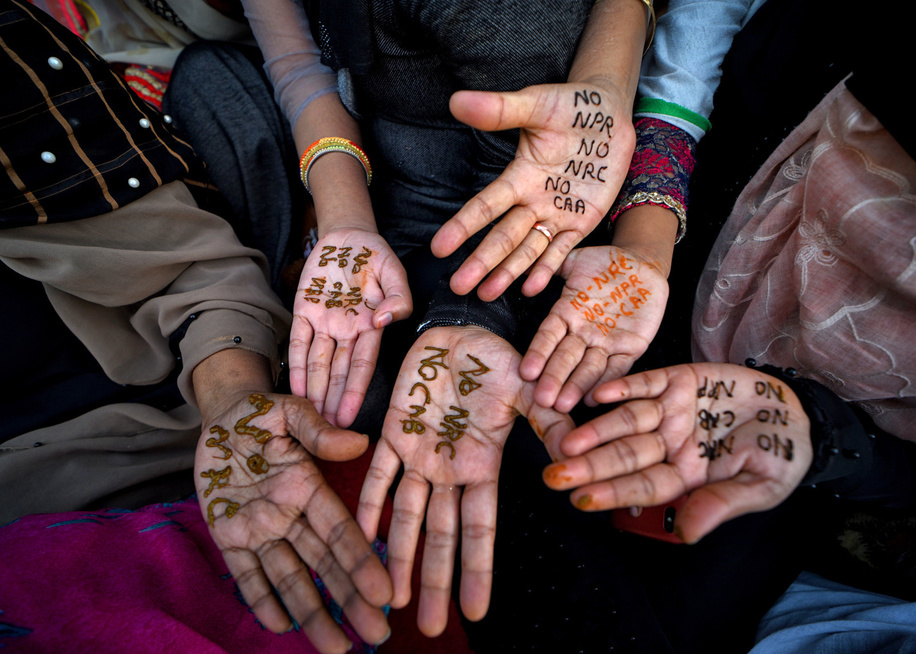 Muslim women display their hands written on NO NRC, NO CAA during the demonstration. A 10 days continuous demonstration against NRC (national register for citizenship) and (Citizenship Amendment Bill) CAB which grants Indian citizenship to non-Muslims of Afghanistan, Pakistan and Bangladesh that was passed by the Indian Government in December 2019 and has created violence, strike and protest all over the India.