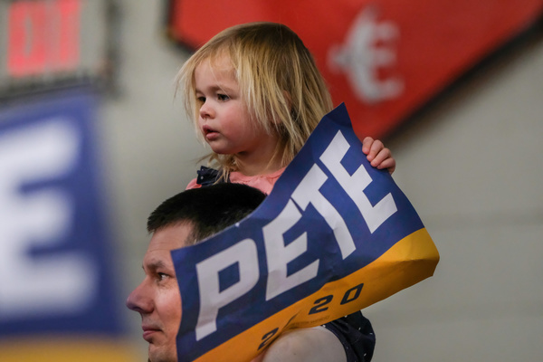 NASHUA, UNITED STATED - FEBRUARY 09 2020: A girls hold a Democratic presidential candidate Pete Buttigieg placard during his campaign stop in Nashua.