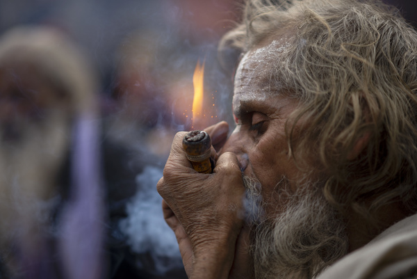 A Sadhu (holy man) smokes marijuana using a chillum (traditional clay pipe) as a holy offering during the festival at Pasupatinath Temple in Kathmandu. Maha Shivaratri is a Hindu festival celebrated annually in honor of Lord Shiva and in particular, marks the night when Shiva performs the heavenly dance.