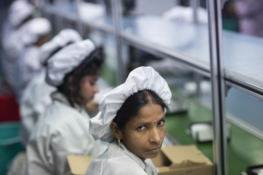 Female technicians assemble smartphones on the production line. Intex Technologies is a Smartphone manufacturer in India and it employs over 3000 technicians for its mobile phone assemble operations in 2017.