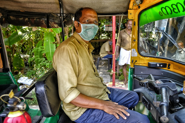 A tuk-tuk driver wears a face mask as a precaution against the spread of Coronavirus in Kochi. With 298 confirmed coronavirus cases, India has already entered Phase 2 of transmission within the community. So far no drastic measures have been taken.