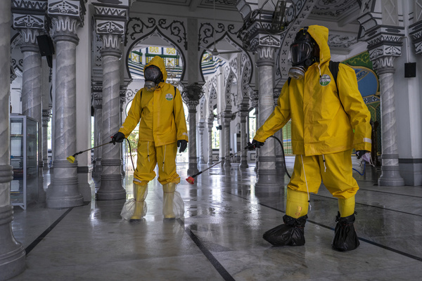 Volunteers from Prevention Task Force for COVID-19 Indonesia spray disinfectants at Bujang Salim mosque as a preventive measure against the spread of COVID-19 Coronavirus in North Aceh. According to media reports, Indonesian authorities have urged the citizen to avoid public gatherings, including religious activities as a precautionary measure against the spread of coronavirus. Indonesian government confirmed 579 for COVID-19 coronavirus cases, 30 people recovered, and 49 people deaths.