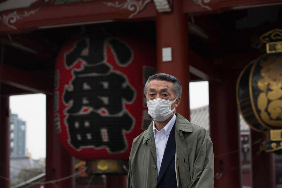 A man wears a protective mask as a preventive measure against Coronavirus at Sens?-ji, an ancient Buddhist temple in Asakusa, Tokyo.