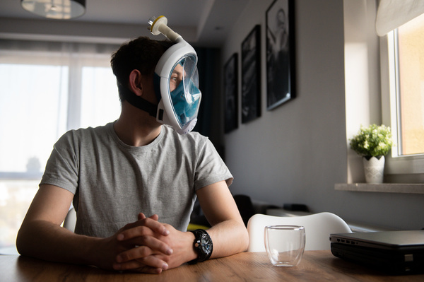 Wojciech Myslinski seen wearing a face mask adapter made from the foundry mold with a HEPA filter that protects against Coronavirus infection by filtering inhaled air. The adapters allow to connect a diving mask with a HEPA filter that protects against Coronavirus infection by filtering inhaled air.  The idea was created by Rock fin company in which Wojciech works.