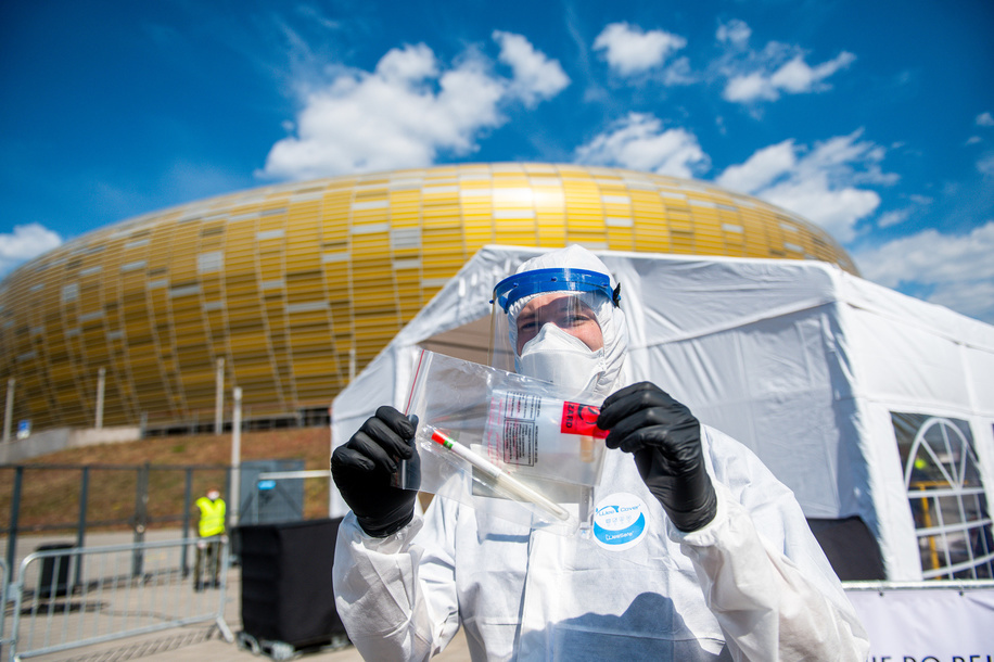 GDANSK, POLAND - APRIL 27, 2020: Medic seen holding a testing kit at the covid-19 mobile testing center in Gdansk.  A mobile testing point for coronavirus was opened in Gdansk on April 27. Potential coronavirus infected people can do the test without leaving the car. In Poland, 11,761 people are infected with coronavirus, 539 have died.
