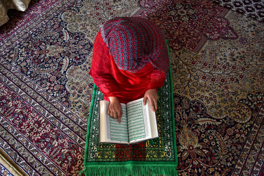 A woman recites the holy Quran during the ongoing month of Ramadan. Muslims throughout the world are marking the month of Ramadan under coronavirus lockdown this year. Ramadan is the holiest month on the Islamic calendar in which devotees fast from dawn till dusk.