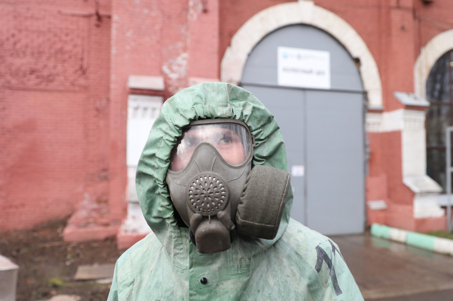 Russian soldier wearing a protective suit disinfects a train factory area to prevent the spread of coronavirus (COVID-19). Russia has recorded at least 24490 cases and 198 deaths by the COVID-19 disease.