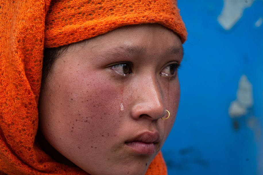 A girl from Birgunj, a city in Nepal, seen crying as she waits for extra check up before entering Kathmandu during the thirty five day of nationwide lockdown imposed by the government amid concerns about the spread of Coronavirus (COVID-19) disease. Locals people have been stopped at the entry point of the capital due to ongoing nationwide lockdown after they were traveling outside of Kathmandu. They will have to undergo extra check up before going back into the capital.