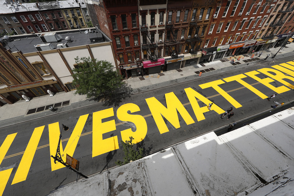 A view of a Black Lives Matter sign painted on Fulton Street in Bedford Stuyvesant community of Brooklyn, a borough of New York City.  The Black Lives Matter protest installation work by a group of artists led by Dawud West, was conceived to raise awareness to social injustice and police brutality predominantly against African Americans.