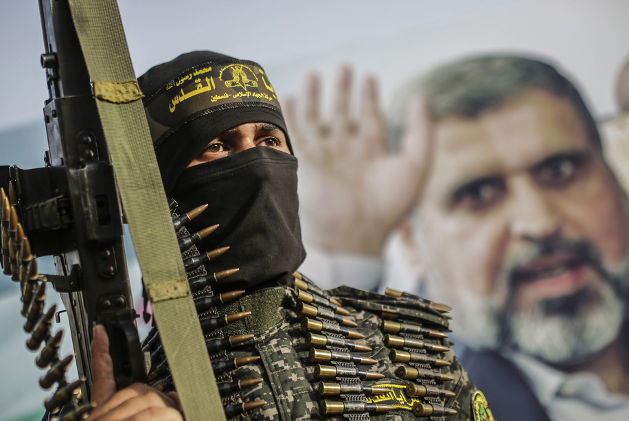 Militants of the Al-Quds Brigades, the armed wing of the Palestinian Islamic Jihad (PIJ) movement take part during a memorial service honouring the PIJ's former leader Ramadan Shallah in Gaza City. Shallah was in a medical coma when he passed away on 06 June in a Beirut (Lebanon) hospital at the age of 62 following an undisclosed chronic disease. His remains have been taken to the capital of Syria, Damascus, to be buried there.