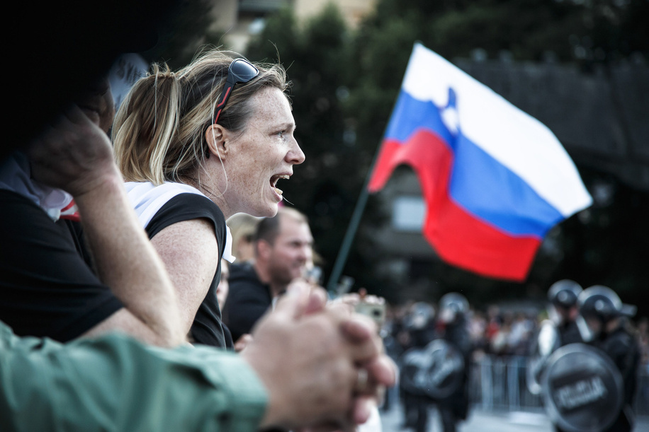 A protester shouts at the police during an anti-government protest.Every Friday, thousands of people in Ljubljana protest against the government of Prime Minister Janez Janöa amid allegations of his governmentís corruption and undemocratic rule.