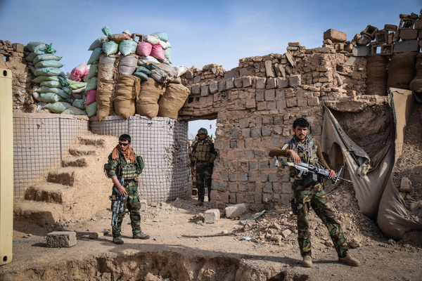 Afghan Commandos inside the remains of an Afghan National Defence and Security Forces outpost behind Farahrud Bazaar, just off the main road in Bolo Bluk district, Farah province. According to the Commandos, the outpost had been recently overrun and razed by Taliban who hold the nearby village. Afghanistan's elite military forces – the Commandos and the Special Forces are one of the key elements in the Afghan and U.S. strategy to turn the grinding fight against the Taliban and other insurgents around. These pictures show the Commandos and Special Forces during training and in the field; also right before and after an operation in the restive western Afghan province of Farah.