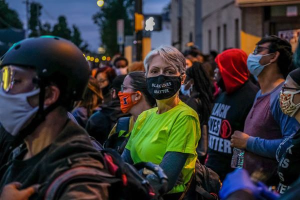 A woman wears a Black Lives Matter mask during the Black Lives Matter rally in Rochester, New York. Black Lives Matter protests continue to flare-up as police and protesters clashed in Rochester after the video of Daniel Prude's death was released earlier this week, that showed his arrest in March. Prude's death was ruled a homicide, and a grand jury was announced on Saturday.