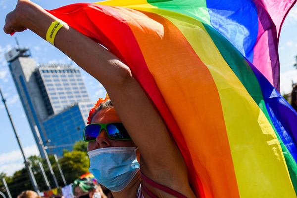 A supporter wears a protective face mask, holding a rainbow flag during the march. LGBT supporters participate in the 4th Edition of the Equality Parade in Katowice, guarded by hundreds of police officers and attracting more than 1500 participants. According to the coronavirus restrictions, public gatherings can't exceed more than 150 people.