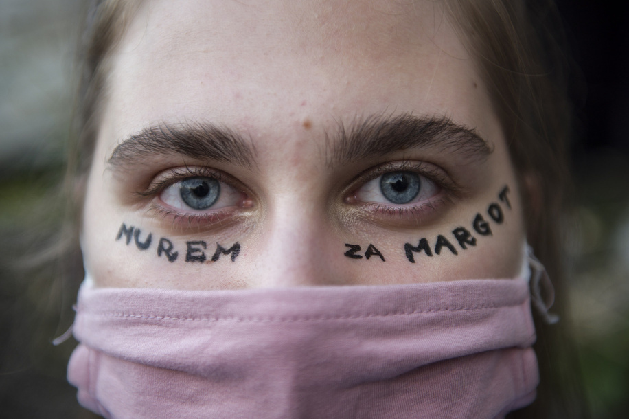 A protester with an inscription in her face saying