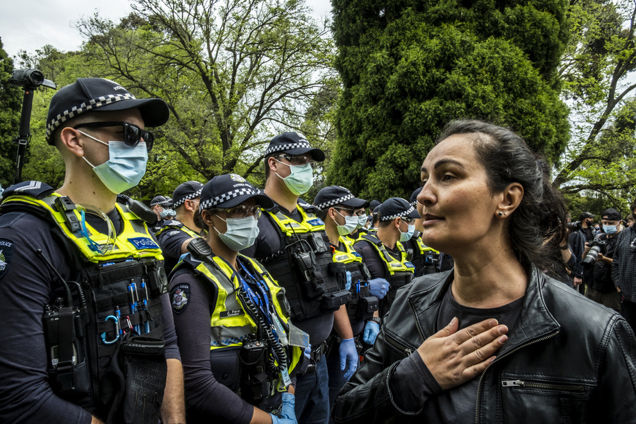 A woman talks to police officers at the Shrine of Remembrance during the demonstration. About 200 to 300 protesters gathered for Freedom Day rally in opposition to Covid19 restrictions. The protest started at Melbourne Shrine Remembrance were protesters held placards while chanting slogans against the Premier Daniel Andrews tough restrictions due to Covid 19.