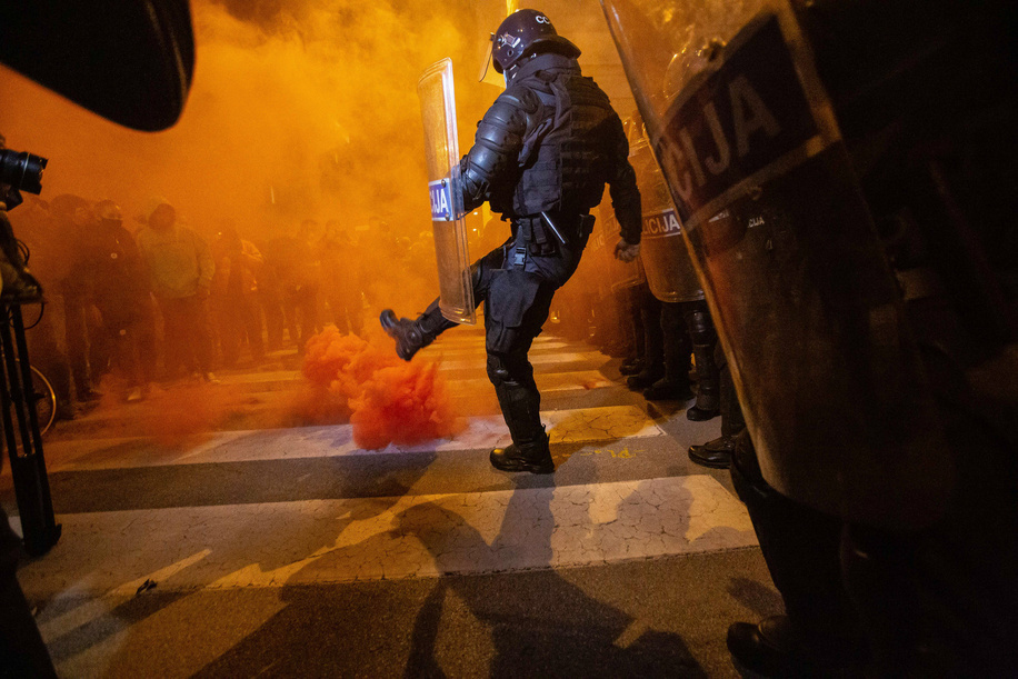 A riot policeman kicks a burning flare during an anti-government protest. For the 25th consecutive Friday, people in Ljubljana protested against the government of Prime Minister Janez Jansa amid continuous reports of its corruption and evidence of Jansaís authoritarian behaviour. The latest protest has faced new covid-19 restrictions on public assembly and government's accusations of protests being a big source of spreading of the virus. Police arrested several protesters from the site and filed violation reports.