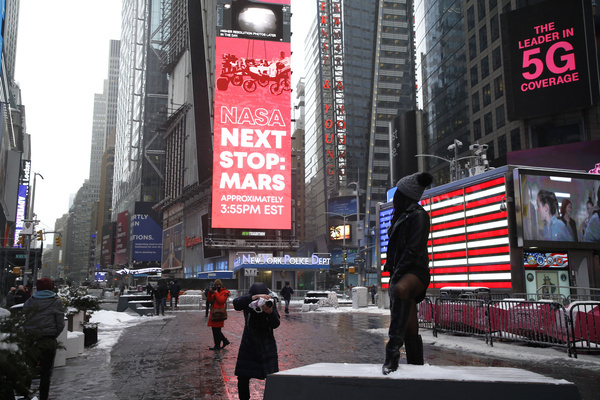 Jumbotron in Times Square displays the announcement of the landing of Perseverance on the surface of Mars. NASA's fifth robotic rover named Perseverance landed on Mars on February 18, 2021. The most technologically advanced rover will perform a variety of tasks over the next two years in order to collect samples from the Mars. The robot fuelled by lithium-ion batteries which are powered by plutonium will use a variety of tools, including a robotic arm, drill, cameras, chemical analyser and a first ever helicopter named Ingenuity. Whole samples will be stored on board of the robot which will be brought back to earth during the future missions to Mars.