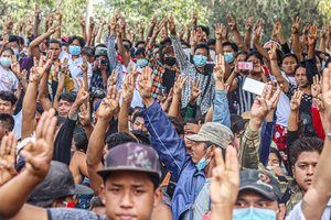 Protesters stand while making the three finger salute during a peaceful demonstration against the military coup. Anti-military coup protesters took to the streets of Mandalay to protest against the military coup and demanded the release of Aung San Suu Kyi. The police and military responded by firing live rounds, killing two protesters and injuring many others. Myanmar's military detained State Counsellor of Myanmar Aung San Suu Kyi on February 01, 2021 and declared a state of emergency while seizing the power in the country for a year after losing the election against the National League for Democracy (NLD).