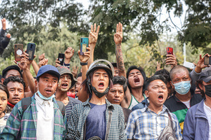 Protesters shout slogans while making the three finger salute during a peaceful demonstration against the military coup. Anti-military coup protesters took to the streets of Mandalay to protest against the military coup and demanded the release of Aung San Suu Kyi. The police and military responded by firing live rounds, killing two protesters and injuring many others. Myanmar's military detained State Counsellor of Myanmar Aung San Suu Kyi on February 01, 2021 and declared a state of emergency while seizing the power in the country for a year after losing the election against the National League for Democracy (NLD).