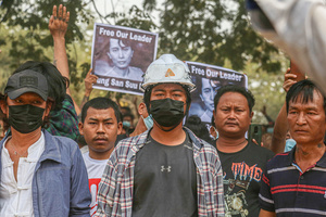 Protesters stand while holding portraits of Aung San Suu Kyi during a peaceful demonstration against the military coup. Anti-military coup protesters took to the streets of Mandalay to protest against the military coup and demanded the release of Aung San Suu Kyi. The police and military responded by firing live rounds, killing two protesters and injuring many others. Myanmar's military detained State Counsellor of Myanmar Aung San Suu Kyi on February 01, 2021 and declared a state of emergency while seizing the power in the country for a year after losing the election against the National League for Democracy (NLD).