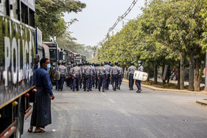 Police seen walking down the street during a demonstration against the military coup. Anti-military coup protesters took to the streets of Mandalay to protest against the military coup and demanded the release of Aung San Suu Kyi. The police and military responded by firing live rounds, killing two protesters and injuring many others. Myanmar's military detained State Counsellor of Myanmar Aung San Suu Kyi on February 01, 2021 and declared a state of emergency while seizing the power in the country for a year after losing the election against the National League for Democracy (NLD).