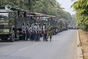 Police and military stand guard next to military vehicules during a demonstration against the military coup. Anti-military coup protesters took to the streets of Mandalay to protest against the military coup and demanded the release of Aung San Suu Kyi. The police and military responded by firing live rounds, killing two protesters and injuring many others. Myanmar's military detained State Counsellor of Myanmar Aung San Suu Kyi on February 01, 2021 and declared a state of emergency while seizing the power in the country for a year after losing the election against the National League for Democracy (NLD).