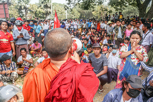 A monk is talking to the crowd during a peacful demonstration against the military coup. Anti-military coup protesters took to the streets of Mandalay to protest against the military coup and demanded the release of Aung San Suu Kyi. The police and military responded by firing live rounds, killing two protesters and injuring many others. Myanmar's military detained State Counsellor of Myanmar Aung San Suu Kyi on February 01, 2021 and declared a state of emergency while seizing the power in the country for a year after losing the election against the National League for Democracy (NLD).
