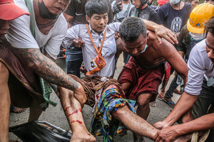 (EDITORS NOTE: Image contains graphic content) Protesters carry a wounded man after police and military open fire on peaceful protesters during a demonstration against the military coup. Anti-military coup protesters took to the streets of Mandalay to protest against the military coup and demanded the release of Aung San Suu Kyi. The police and military responded by firing live rounds, killing two protesters and injuring many others. Myanmar's military detained State Counsellor of Myanmar Aung San Suu Kyi on February 01, 2021 and declared a state of emergency while seizing the power in the country for a year after losing the election against the National League for Democracy (NLD).