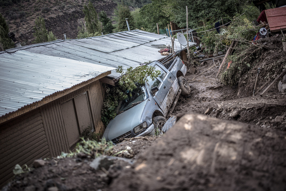 View of a damaged and buried pickup truck due to landslides. Strong frontal system ended with hundred people affected and more than a hundred homes damaged by floods, alluvium and landslides in San José de Maipo towns, San Alfonso were one of the sludge most complex area.