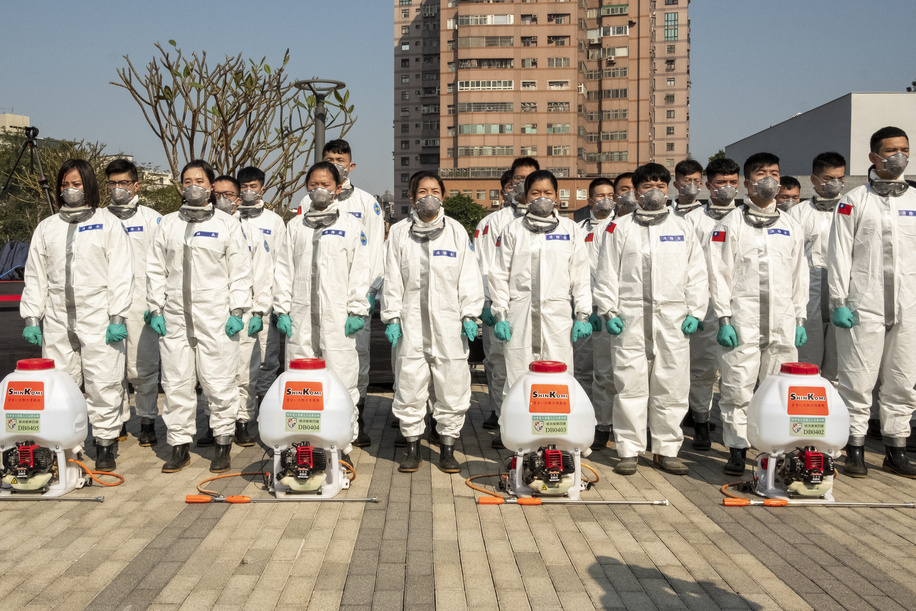 Soldiers seen lined up dressed in protective facemasks and personal protective equipment suits (PPE) in preparation for disinfecting Taoyuan. Taiwan's Army deployed soldiers from the 33rd Chemical Warfare Group to spray disinfectant in the areas confirmed Covid19 cases had recently visited, in response to the frightening spike of new local cases.