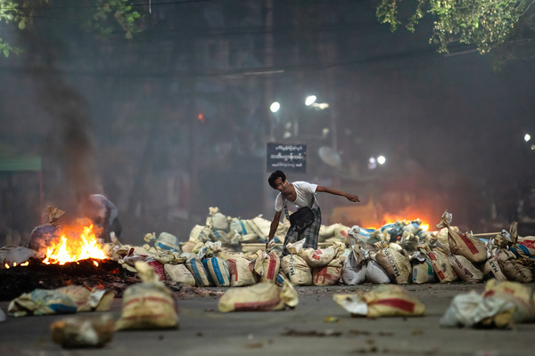 A protester pilling bags as barricades during the demonstration.Myanmar military attack protesters with rubber bullets, live ammunition, tear gas and sound bombs in response. The death toll for today is 144 and the highest death toll since the military coup in February 1.