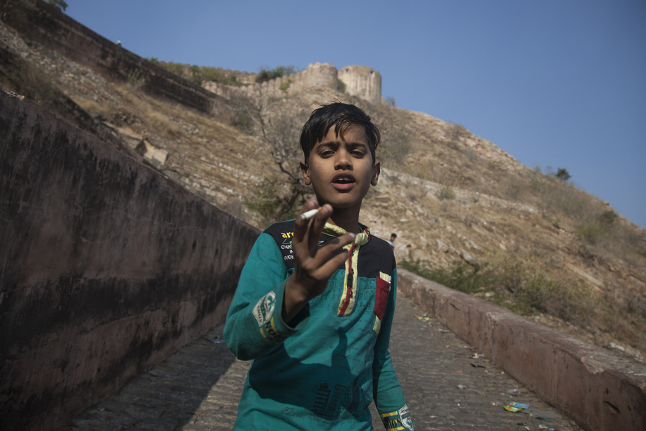 A young boy holding a cigarette in his hand. The partition of India accompanied the creation of two independent states, India and East and West Pakistan (East Pakistan now known as Bangladesh). India was formed out of the majority Hindu regions, while Pakistan from the majority Muslim regions. The partition saw many people displaced and overwhelming inter communal violence. By 1948, as the great migration drew to a close, almost two million people from both sides, were dead. The violence was particularly bad in the states straddling the new borders, including Punjab, Kashmir, Bengal, and Sindh. However, despite Rajasthan being the largest state along the border, it saw relatively little violence compared to its neighbor states. Today, around 7% of Rajasthan's population are Muslim, often living in small, isolated villages scattered along Pakistan's border in the Thar Desert. Muslims and Hindus are still co - existing here as they were during one of the wider regions most violent past times. Muslims in Thar avoid eating cow meat out of respect for Hindus, and during the month of Ramadan Hindus do not eat in front of their fasting Muslim neighbors.
