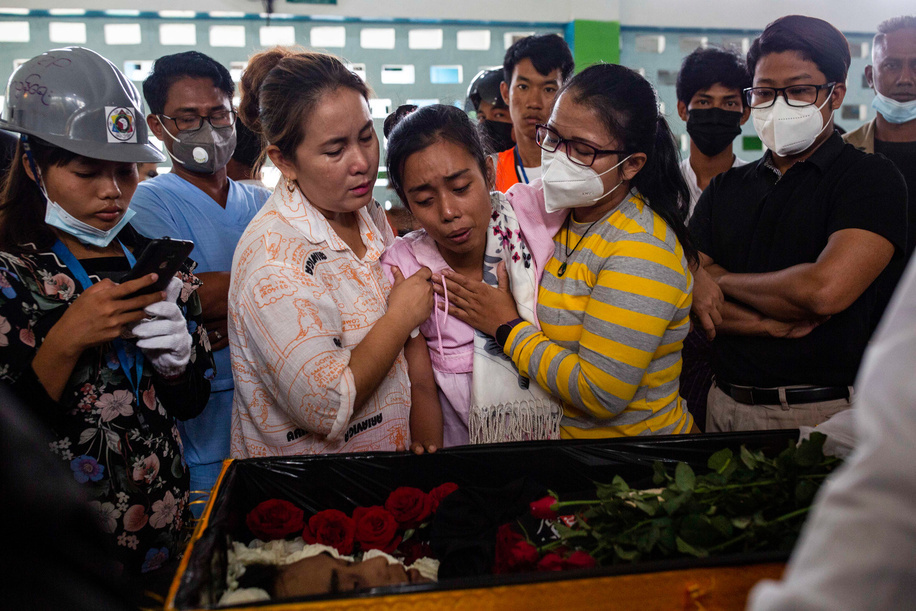 (EDITORS NOTE: Image depicts death)  Relative react at the funeral of Chit Min Thu, a pro-democracy protester killed by Security Forces during a demonstration against the military coup in Yangon where Myanmar Security Forces attacked protesters with rubber bullets, live ammunition, tear gas and stun bombs killing several protesters. Myanmar's military detained State Counsellor of Myanmar Aung San Suu Kyi on February 01, 2021 and declared a state of emergency while seizing the power in the country for a year after losing the election against the National League for Democracy (NLD).