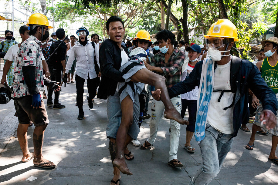 Anti military coup protesters carry a wounded protester shot by the police and military during a demonstration against the military coup. Myanmar police and military soldiers (tatmadow) attacked protesters with rubber bullets, live ammunition, tear gas and stun bombs in response to anti military coup protesters on Friday, killing several protesters and injured many others. At least 149 people have been killed in Myanmar since the 1 February coup, a UN human rights official has said. Myanmar's military detained State Counsellor of Myanmar Aung San Suu Kyi on February 01, 2021 and declared a state of emergency while seizing the power in the country for a year after losing the election against the National League for Democracy (NLD).