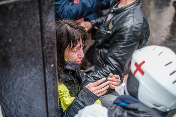 A protester is treated for the effects of tear gas by a volunteer medic during the demonstration.Protesters took to the streets of Paris as part of the International Workers Day protests to demand social and economic justice and voice their opposition to government plans to change unemployment benefits.